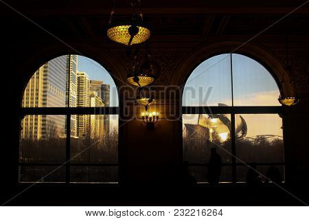 Chicago, Illinois, Usa - December 28 2014: Sunset Reflections In Metal Constructions Of Jay Pritzker