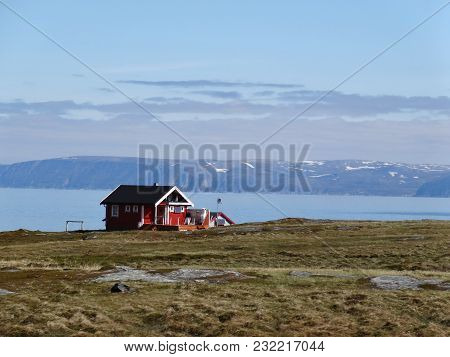 Norway Landscape With Red Fishing House And Deep Blue Sky