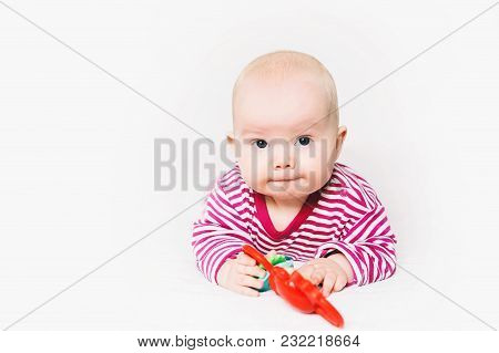 Smiling Cutest Baby Playing With Colorful Toys. Сut Out On A White Background. Happy 6 Months Old Ba