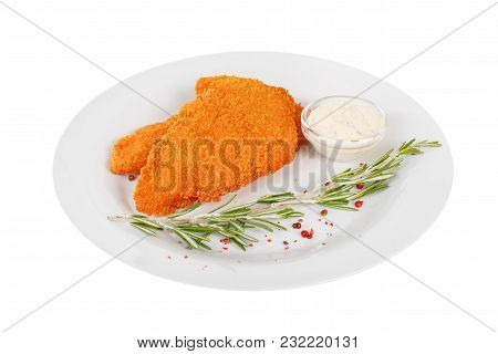 Schnitzel Is Cut Into Pieces Of Chicken, Pork, Meat, Grilled, Barbecued, With Red Pepper And Rosemar