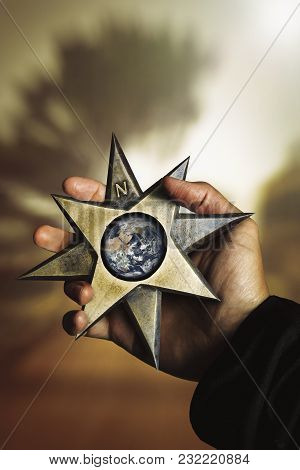Hand Holding Compass Star Wind Rose With Earth. Compass Star Windrose With Planet Earth In Hand. A H