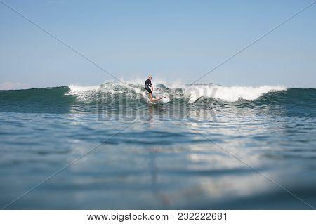 Active Man Surfing Wave On Board In Ocean