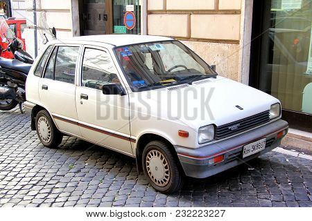 Rome, Italy - August 1, 2014: Compact Motor Car Maruti 800 In The City Street.