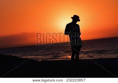 Silhouette Man In Hat With Hand In Sunset Beach In Varadero, Cuba. Travel Concept. Summer On The Bea