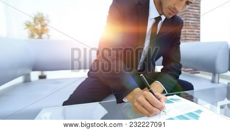 businessman working with a financial report.