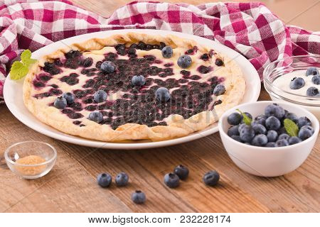 Blueberry Tart With Sour Cream On White Dish.