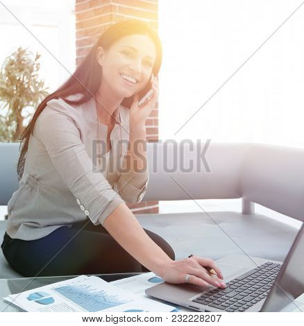 Modern business woman discussing financial problems on smartphone