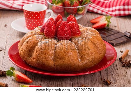 Strawberry Cake With Spices On Red Dish.