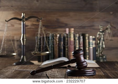 Law And Justice Symbols On Brown Background. Books, Scales, Gavel.