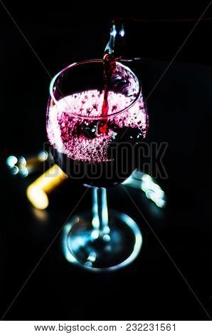 Pouring Red Wine In A Glass, Celebration Of A Moment With A Glass Of Wine, Exquisite Liquor For Gour