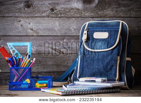 The School Bag On Old Wooden Background