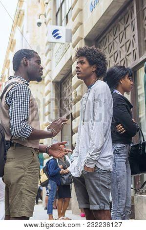 Havana, Cuba - January 04, 2018: Two Dark-skinned Young People Cry Out On Havana Street In Cuba