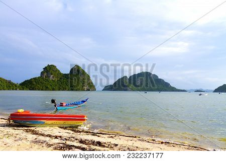 Beach Bang Boet And Red Small Boat At Chumphon Province,thailand Is Famous For Travel