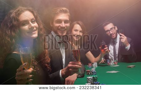 poker players sitting at a table in a casino