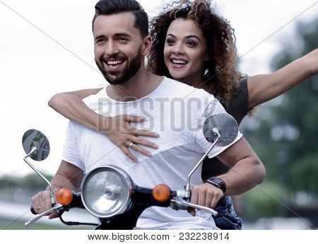 Happy couple driving scooter excited on summer holidays vacation