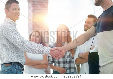 handshake business partners in the creative office.