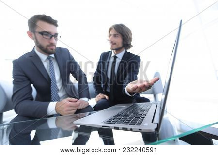 Two businessmen working on a project together
