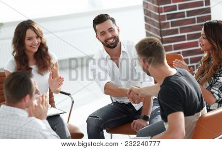 friendly handshake colleagues when meeting