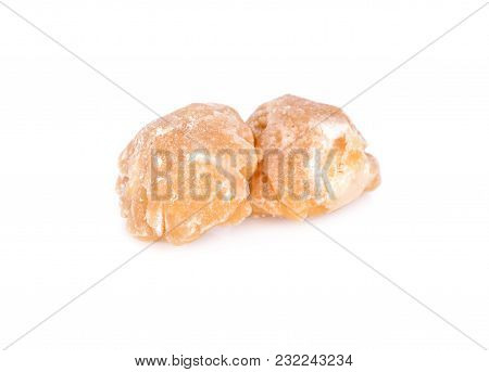 Unbleached Palm Sugar On A White Background