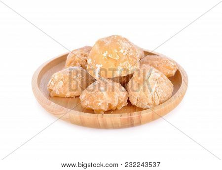 Unbleached Palm Sugar In Wooden Plate On White Background