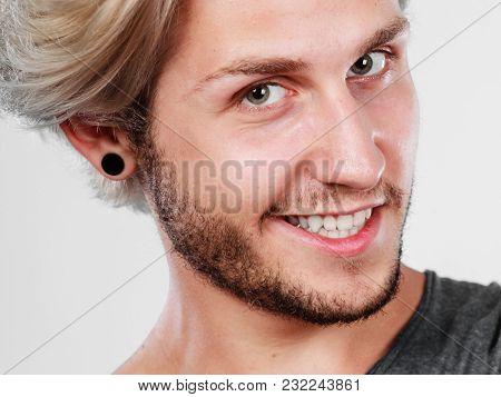 Fashion, Happiness, Joy Concept. Happy Smiling Blonde Man Wearing Grey T Shirt, Studio Shot Close Up