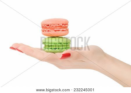 Woman Hand Showing Or Giving Two Macaroons Isolated With Clipping Path