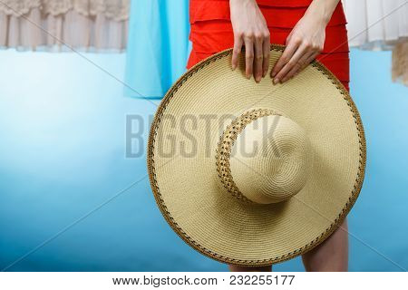Woman Hand Holding Summer Accessory, Beige Sun Hat Perfect For Vacations Time.