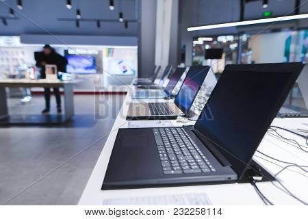 Laptops On The Table In The Electronics Store. The Department Of Laptops In The Tech Store. Buy A La