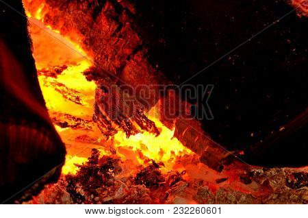 Close-up Detail Of Hot Wood And Embers In Fireplace