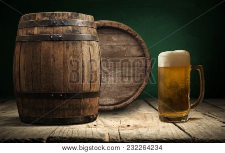 Oktoberfest Beer Barrel And Beer Glasses With Wheat And Hops On Wooden Table.