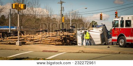 March 10, 2017: Carrboro Nc Usa-overturned Logging Truck With Work Men And Fire Engine