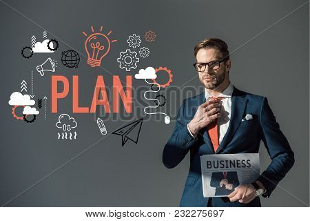 Handsome Young Man In Eyeglasses Holding Newspaper And Adjusting Necktie, Plan Icons Isolated On Gre