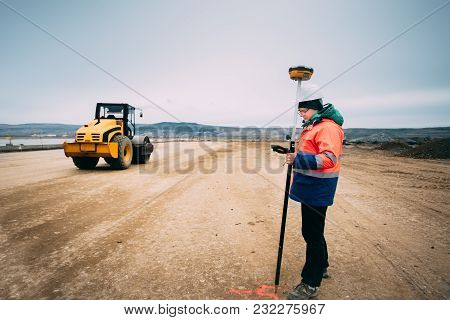 Portrait Of Engineer On Construction Site, Surveyor Using Gps System And Theodolite On Highway Const