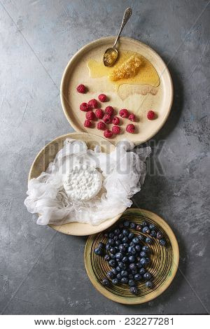 Fresh Homemade Cottage Cheese In Cheesecloth Served In Ceramic Bowl With Blueberries, Raspberries An