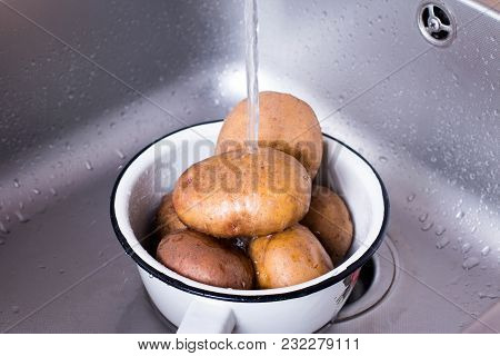 Potatoes Washing Under Running Water. Potatoes Washing Under Tap Water. Wash Potatoes