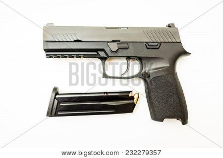 New Handgun With Magazine And Rounds