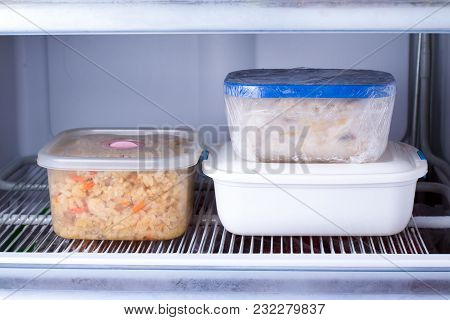 Frozen Food In A Container In The Freezer. Refrigerator With Frozen Food. Ready Meal