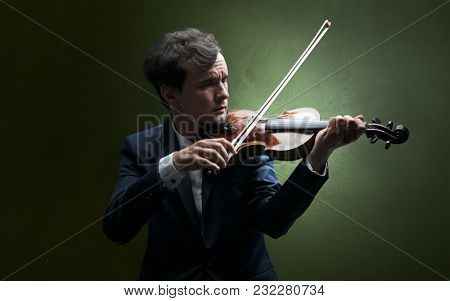 Lonely violinist composing on cello with nothing around