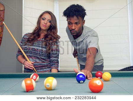 Two Friends Playing Pool Billiards Table Man And Women Flirting