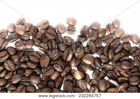 Black Coffee Grains Isolated On The White Background. Copy Space