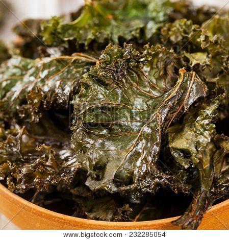 Homemade Baked Crispy Kale Chips. Selective Focus.