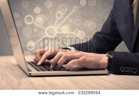 An office salesman in elegant suit working on a scientific project with the help of a laptop concept