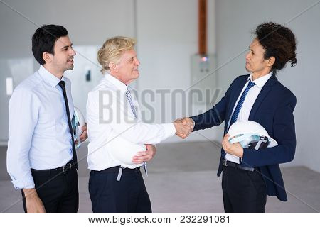 Confident Asian Entrepreneur Starting Construction Business And Making Handshake With Building Contr