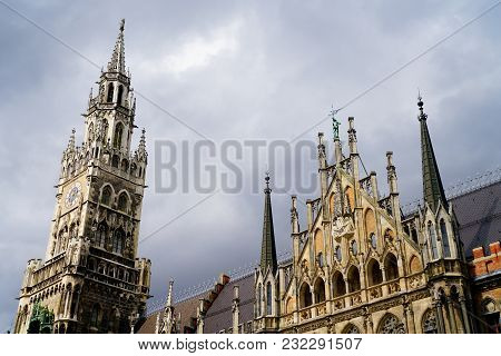 Munich New Town Hall Skyline Image Of Main Tower And Spire Against Dark Moody Sky.