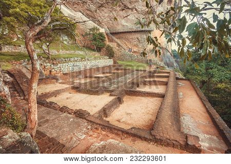 Tourists Descending From The Mountain In Ancient Sigiriya City With Ruins And Archeological Area. Un