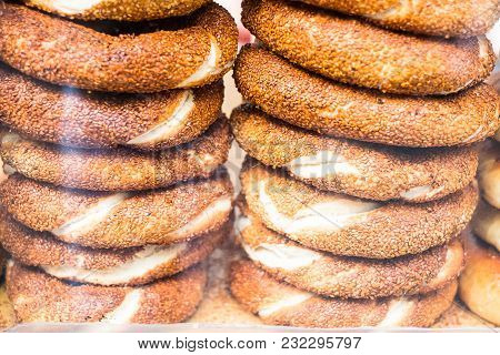 Traditional Turkish Bread Called Simits In A Ring Shape Sprinkled With Sesame Seeds Stacked, Selecti