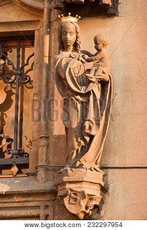 Figure Of The Holy Mother Mary With A Child On The Facade Of The Building