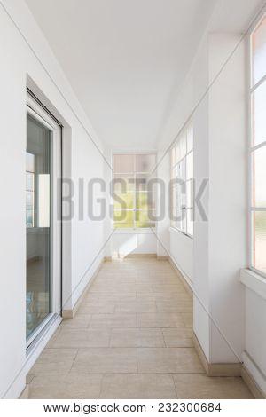 Bright corridor with large windows
