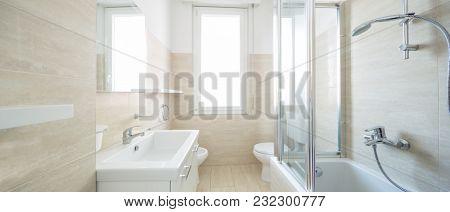 Modern empty bathroom illuminated