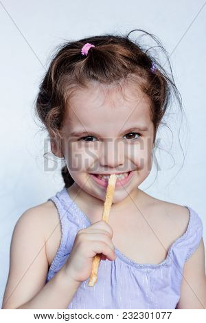 Little Kid Girl Holding Miswak In Hands And Making Teeth Cleaning Procedure